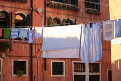 Clothes hanging. To dry on a clothes-line Stock Photos