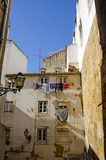 Clothes Hanging From Apartments in Lisbon Portugal Royalty Free Stock Photography