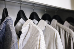 Clothes hanging in Closet Shop Fashion display Royalty Free Stock Images