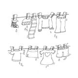 Clothes hanging clothes hanging with clothespins chine coloring humorous children Royalty Free Stock Photography