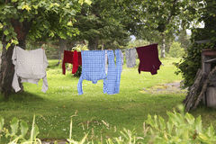 Clothes hanging on clothesline  to dry Royalty Free Stock Image