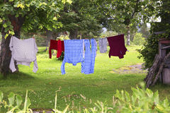 Clothes hanging on clothesline to dry royalty free stock photo