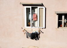 Clothes hanging on the facade of a building Stock Photography