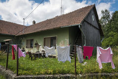 Clothes hanging in front of a village house on the edge of a forest Stock Photography