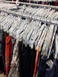 Clothes hanging on hangers Royalty Free Stock Photography