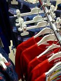 Clothes hanging on hangers Royalty Free Stock Photos