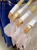 Clothes hanging on hangers Stock Photography