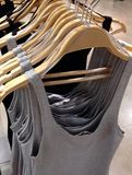 Clothes hanging on hangers Stock Image
