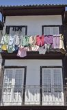 Clothes hanging on house Stock Photos