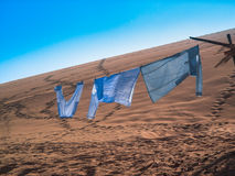 Clothes hanging Stock Photography