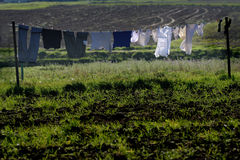 Clothes hanging on a line Stock Images