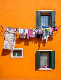 Clothes hanging on line in Burano Royalty Free Stock Image