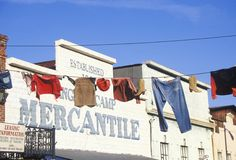 Clothes hanging on line outside Mercantile Stock Photo