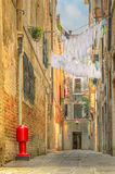 Clothes hanging out to dry between old houses in Venice Stock Image