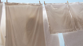 Clothes hanging out to dry. Pillowcases and towels hanging out to dry stock photos