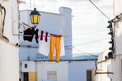 Clothes hanging out to dry in a street of Elvas, Portugal Royalty Free Stock Image