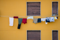 Clothes hanging outside house drying to the sun Stock Image