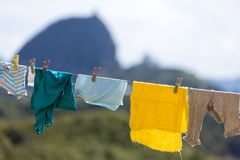 Clothes hanging with the Piedra el Penol in Guatape in backgroun Stock Images