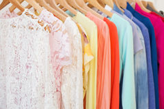 Clothes hanging on the rack Stock Image