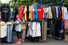 Clothes hanging on a rack in a flea market Stock Photography