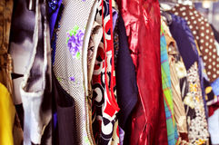 Clothes hanging on a rack in a flea market. Some different used clothes hanging on a rack in a flea market stock images