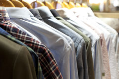 Clothes hanging on the rack Stock Photos