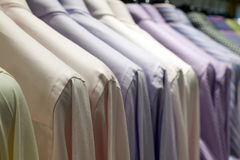 Clothes hanging on the rack Royalty Free Stock Photos