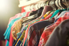 Clothes hanging on the rack in the store Stock Images