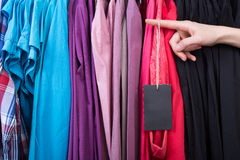 Clothes hanging on the rack in the store Stock Photography