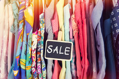 Clothes hanging on the rack in the store Royalty Free Stock Photo