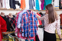 Clothes hanging on the rack in the store Royalty Free Stock Images