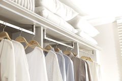 Clothes hanging on rail stock images
