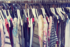 Clothes hanging on a rail. At the shop Royalty Free Stock Photography