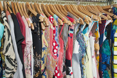 Clothes hanging on a rail Stock Image