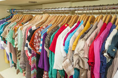 Clothes hanging on a rail Royalty Free Stock Photography