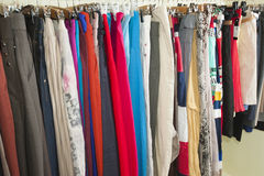 Clothes hanging on a rail Stock Photo