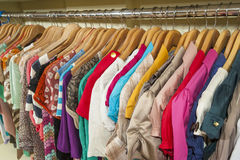 Clothes hanging on a rail Royalty Free Stock Image