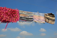 Clothes hanging on a rope Stock Image
