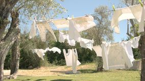 Clothes hanging on rope. stock footage