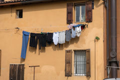 Clothes hanging in the sun. Washed clothes hanging out to dry in the sun Royalty Free Stock Images