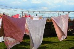 Clothes hanging to dry on a laundry line Royalty Free Stock Photo