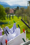 Clothes hanging to dry Stock Photos