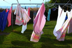 Clothes hanging to dry on a laundry line Stock Images