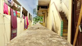 Clothes hanging to dry outside apartment building. Indian hang clothes outside racks for drying. Clothes hanging to dry outside apartment building. Indian hang stock footage