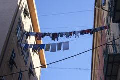 The clothes hanging between two buildings in suburban oh Genoa stock photo