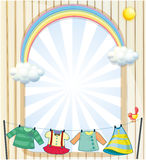 Clothes hanging under the sun near an entrance Royalty Free Stock Images