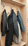 Clothes hanging on a wall Royalty Free Stock Photo