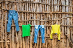 Clothes hanging on wall of a wooden hut in Africa Stock Photography