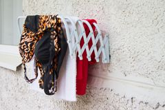 Clothes horse on the balcony. Drying colorful clothes. Stock Photos