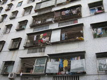 Clothes hung from apartments. Clothes hung from balconies on apartment building Royalty Free Stock Photo